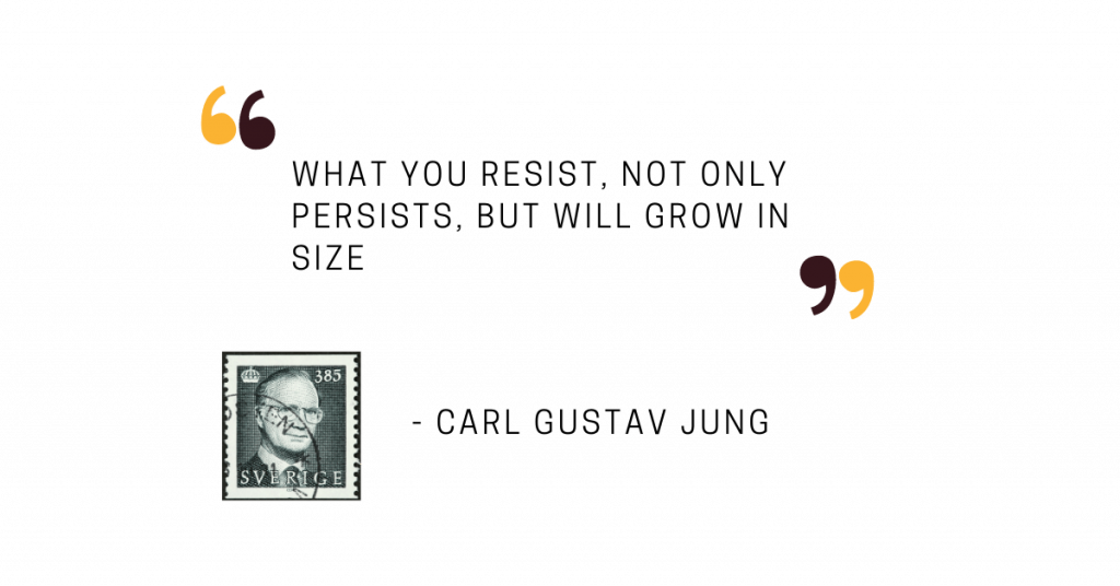 """A quote from Carl Gustav Jung saying """"What you resist not only persists, but will grow in size."""" You can also see a stamp which features a portrait of C.G. Jung."""